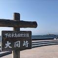 本州最北端の地・大間崎 右手奥に小さく見えるのが弁天島に建つ大間埼灯台 大湊線下北駅から車で1時間ちょっとかかります。