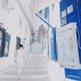 エーゲ海 イドラ島 白いお洋服の方、眩い光の中で風景と一体化。