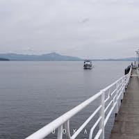 2021/10/21 今津港に帰港する船。 左手に竹生島。 前日は欠航だったらしい。 #竹生島クルーズ #今津港