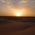 モロッコ。サハラ砂漠の夕陽。
